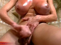 Latina tranny plays with her massive boobs in the bathroom