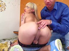 Stunning Blonde Shemale Enjoys a Young Stud
