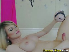 Busty blonde tranny is a wild one! She unloads her jizz all