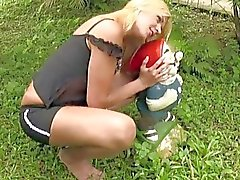 Naughty blonde shemale exposes tiny tits and penis outdoors