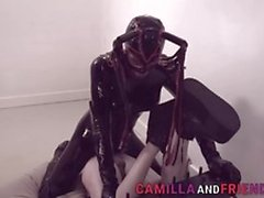 Naughty Fetish shemale in latex suit and mask fucks