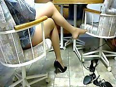 Legs in pantyhose and pumps